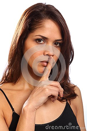 Beautiful young woman makes keep quiet sign
