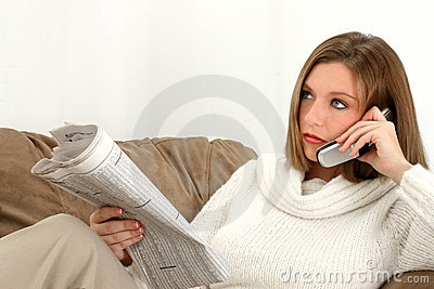 Beautiful Young Woman with Newspaper and Cellphone