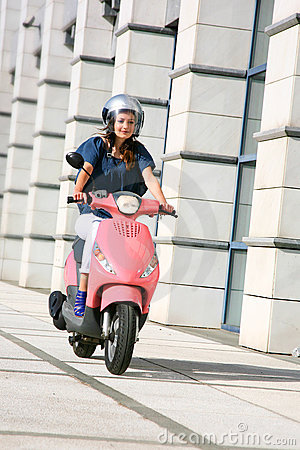 Free Beautiful Young Woman On Scooter Stock Photo - 19134310