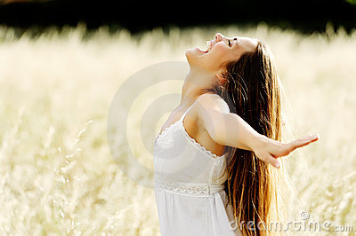 Beautiful young woman in an open field