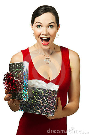 Beautiful young woman opening gift