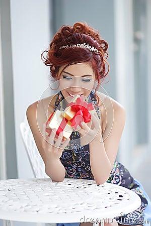 Free Beautiful Young Woman Opening Gift Box Stock Image - 32334371