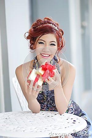 Free Beautiful Young Woman Opening Gift Box Stock Photos - 32334473