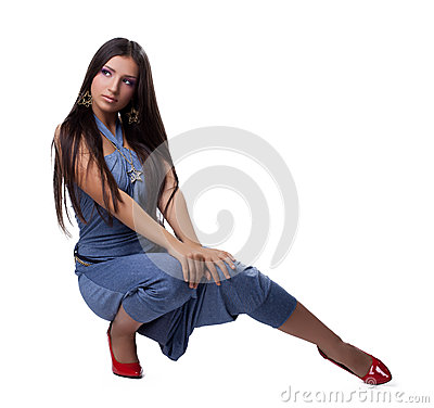 Beautiful young woman in overalls