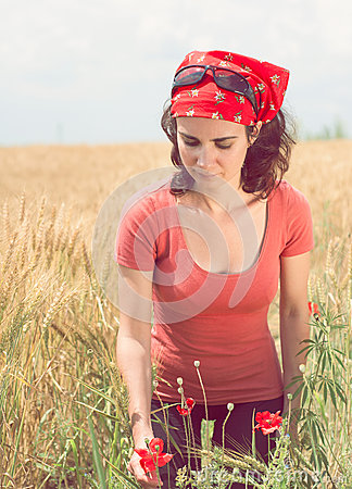 Free Beautiful Young Woman Picking A Poppy Stock Images - 61366194