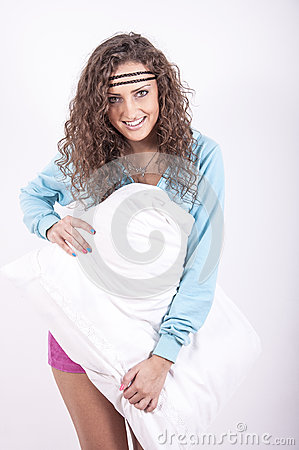 Beautiful young woman with pillow
