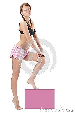 Beautiful young woman in pink shorts
