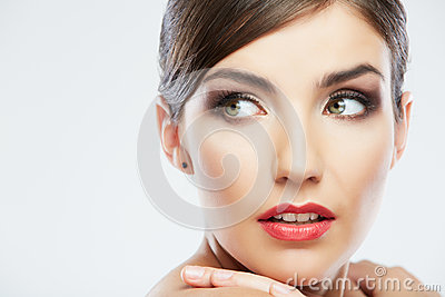 Beautiful young woman portrait   on studio backgro