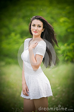 Free Beautiful Young Woman Posing In A Summer Meadow. Portrait Of Attractive Brunette Girl With Long Hair Relaxing In Nature, Outdoor Stock Photos - 45917273