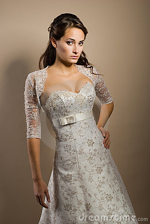 Beautiful young woman posing in a wedding dress