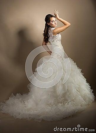 Beautiful young woman posing in a wedding dress