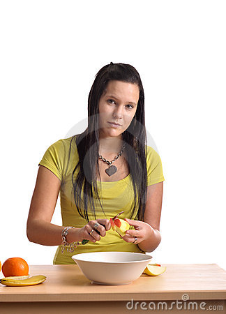 Beautiful young woman  preparing a fruit salad
