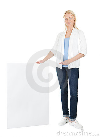 Beautiful young woman presenting empty board