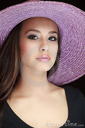 Beautiful Young Woman with Purple Hat