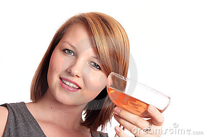 Beautiful young woman raising a glass of bubbly