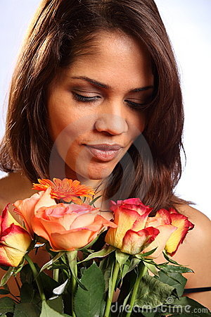 Beautiful young woman receives rose flowers