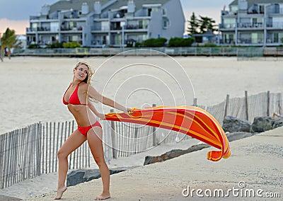 Beautiful young woman in red bikini - with towel