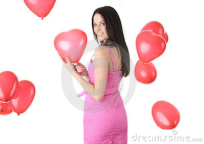 Beautiful young woman with red heart balloon