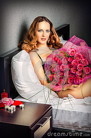 Beautiful Young Woman With Red Roses Royalty Free Stock Photos - Image: 27880268