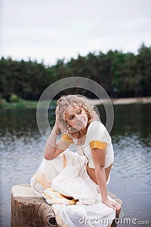 Beautiful young woman relaxing near the lake