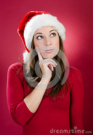 Beautiful young woman with santa hat thinking