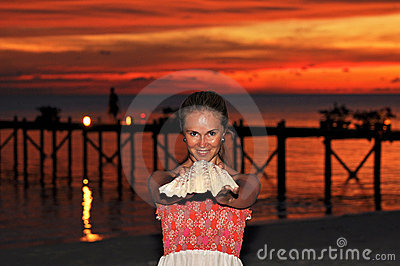 Beautiful Young Woman with Seashell