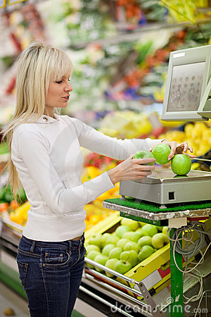 Beautiful young woman shopping for vegetables