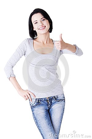 Beautiful young woman showing thumbs up sign