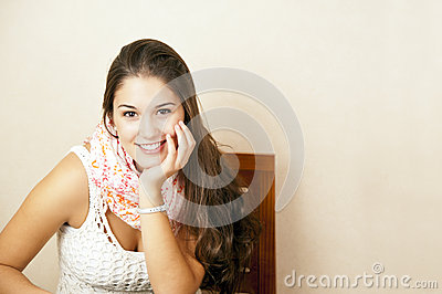 Beautiful young woman sitting in a chair