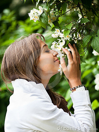 Free Beautiful Young Woman Smelling Stock Photo - 23878310