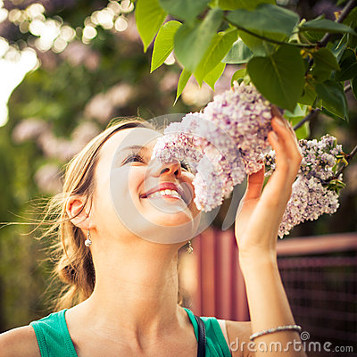 Free Beautiful Young Woman Smelling Jasmin Flowers Stock Images - 48589674