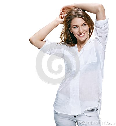Beautiful young woman smiles to the camera isolated on white background