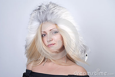 Beautiful young woman smiling in fur hat