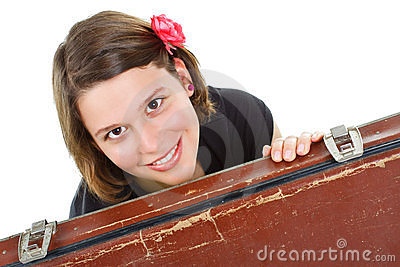 Beautiful young woman smiling by suitcase