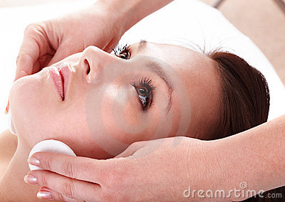 Beautiful young woman in spa. Facial