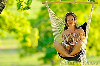 Beautiful young woman swinging outdoor