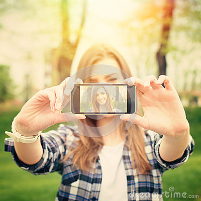 Free Beautiful Young Woman Taking A Selfie Photo With Phone Stock Image - 40480161