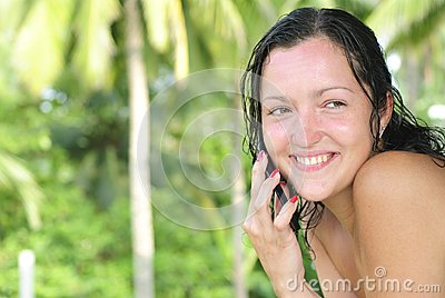 Beautiful young woman talking on cellphone