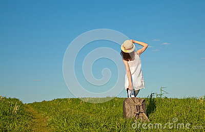 Beautiful young woman travelling with a suitcase