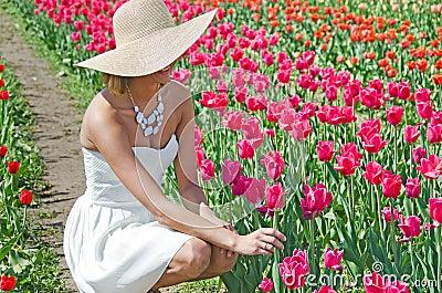 Beautiful young woman in tulips