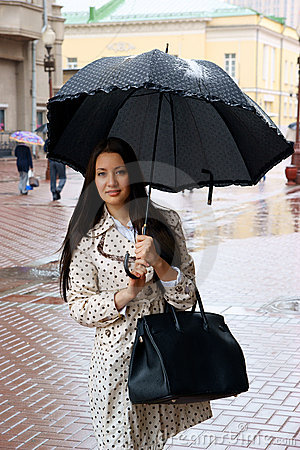 Beautiful young woman with umbrella
