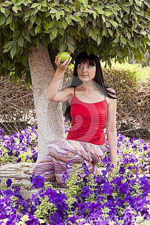 Beautiful young woman under tree