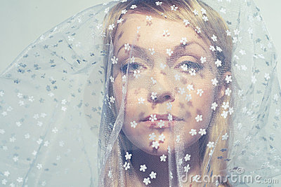 Beautiful young woman under a veil