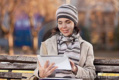 Beautiful young woman using a digital tablet
