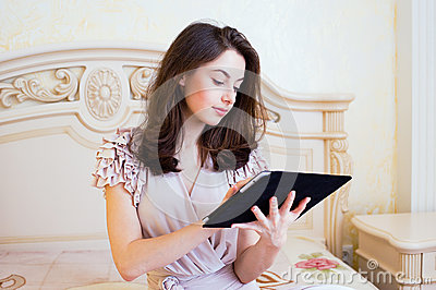 Beautiful young woman using digital tablet computer