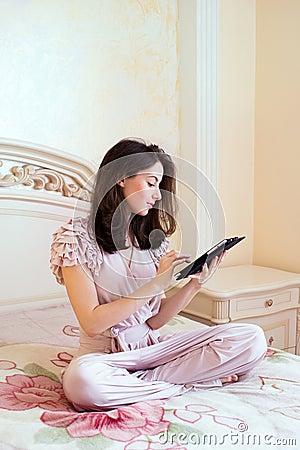 Beautiful young woman using digital tablet computer