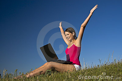 Beautiful young woman using a laptop, and happy.