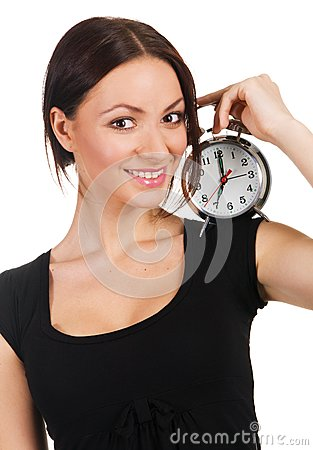 Beautiful young woman with vintage alarm clock