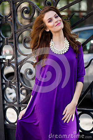 Beautiful young woman with violet dress Stock Photo