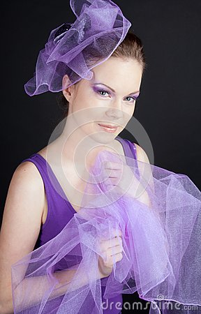 Beautiful young woman in violet hat